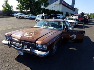 A Brown 70's Olds, love it.